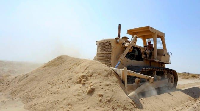 bulldozer moving sand