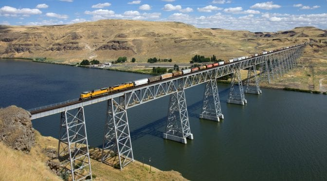 train on a bridge over a river