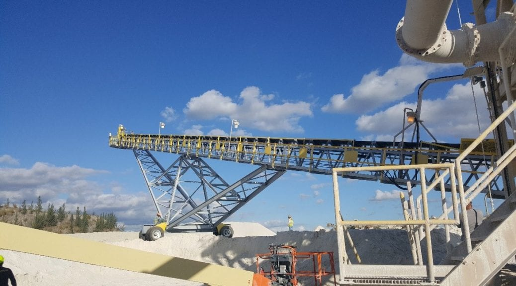 yellow conveyor and blue sky