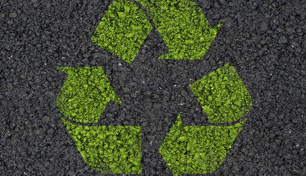 recycling symbol painted on asphalt